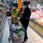 Shoppers wearing masks in a grocery store